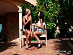 Two amateur lesbians are outside and passionately kissing and rubbing