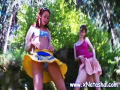 Two teen lesbians are out in the woods and rub their pussies