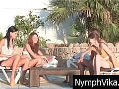 Russian teens by the pool share a cock and take turns blowing
