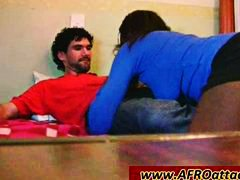 Hot African bitch sucking a thick white penis