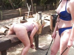 Spanking outdoors