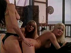 An erotic classic lesbian strapon threesome