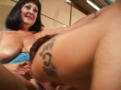 Thumb: Mature lady does girl ...