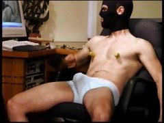 Self abuse. Hot young dude bashes his own balls through his underwear.