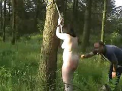 Chubby Slave Tied to Tree