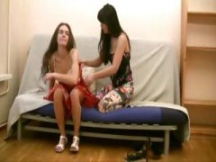 Two young brunette lesbians do some serious pussy licking on couch