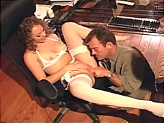 Pretty blonde wearing white stockings and a garter fucking