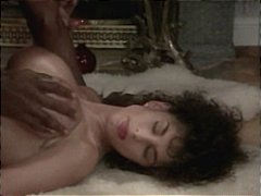 Vintage brunette star Sarah Young gets hammered in the ass by a big black cock