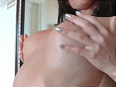 Thumb: Brunette oils up tease...