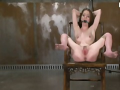 Naughty brunette slave Jessie is tied to a chair, gagged and tortured