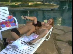 Busty lesbians have sex poolside
