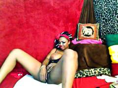 Nuvid Movie:Busty ebony is using a dildo o...