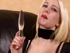 Swedish blonde Emma using a glass dil...