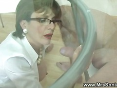 Cuckold watches wife give tugjob thro...