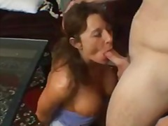 Milf drops to her knees to blow sporty guy