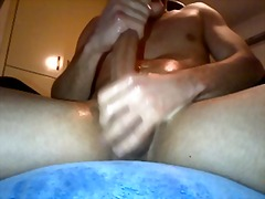 Jerking oily cock and cum