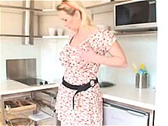 boobsy mature lady plays in the kitch...