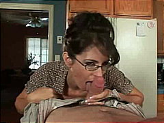 Milf in glasses and dress sucks cock