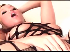 Busty blonde masturbates in a bodysto...