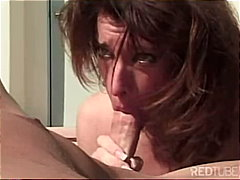 Blowjob by brunette in...