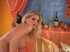 Blond slut strokes her...