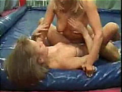 Two girls in plastic bed rubbing