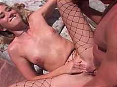 Chick in fishnets lick...