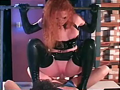 Redhead fucking in gloves and a latex uniform