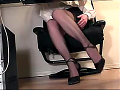 Under desk view of a secretary masturbating in heels and stocking