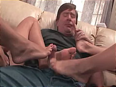 Two blondes giving a kinky footjob in...