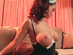 Big boobed maid Nikki Nova teases in uniform panties and stockings