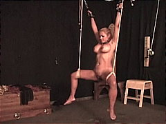 A sexy body tied up in ropes and chai...