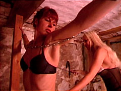 Brunette gets chained up by blonde mi...