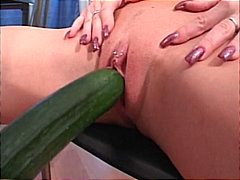 Horny blonde fucked by cucumber and b...