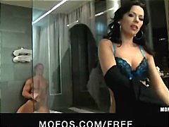 Hot brunette MILF stuffs his cock in ...