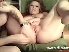 Mature housewife has her legs spread ...