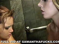 Two busty lesbians play in the bath a...