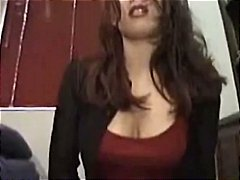 Busty brunette rides a sybian in her ...