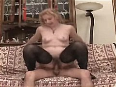 Mature blonde eats his cock and then ...