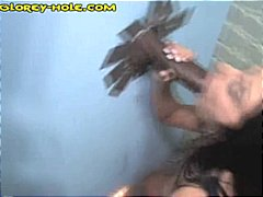 Brunette gets two hard black cocks in...
