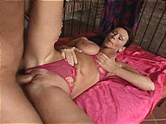 Busty mature German brunette has big natural tits and rides his cock