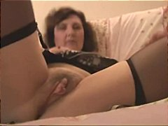 Nuvid Movie:Busty mature strips down and s...