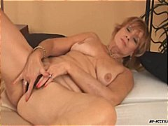 Mature redhead gets naked and blows b...