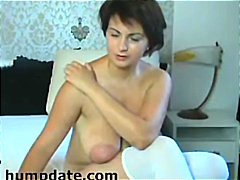 Brunette MILF with big boobs and huge...