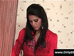 Nuvid Movie:Hot brunette in red sucks on a...
