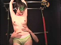 Busty Japanese girl is strung up by her master and gets pussy poked