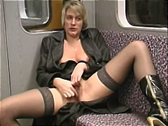 Horny, mature blonde masturbates on the subway and sucks cock POV
