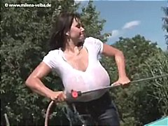 Brunette MILF, Milena Velba gets her white t-shirt wet to show off her massive tits