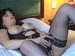 Chubby mature brunette loves playing ...