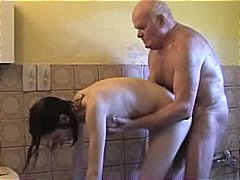 Nuvid - Young brunette helps grandpa take a shower and dries his cock with her mouth